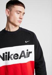 Nike Sportswear - AIR - Bluza - black/university red/white - 4