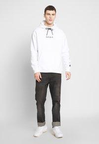 Nike Sportswear - HOODIE - Hoodie - white/black - 1