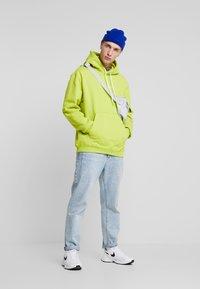 Nike Sportswear - HOODIE - Hoodie - bright cactus/white - 1
