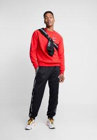 Nike Sportswear - Bluza - university red/white - 1