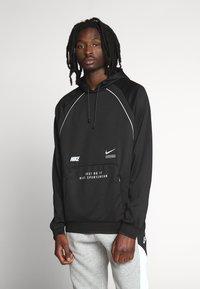 Nike Sportswear - HOODIE - Bluzka z długim rękawem - black - 0