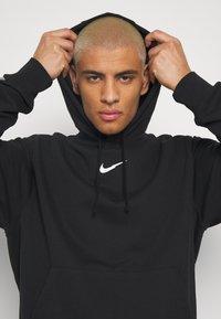 Nike Sportswear - HOODIE - Jersey con capucha - black - 3