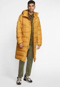 Nike Sportswear - Down coat - gold suede - 1