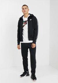 Nike Sportswear - HOODIE TRIBUTE - Sportovní bunda - black - 1