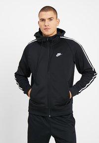 Nike Sportswear - HOODIE TRIBUTE - Sportovní bunda - black - 0