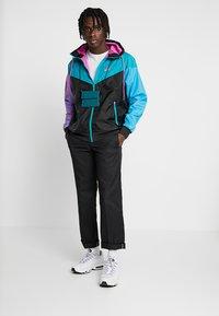Nike Sportswear - Korte jassen - black/spirit teal/space purple/active fuchsia - 1