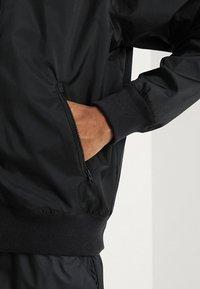 Nike Sportswear - Wiatrówka - black - 5