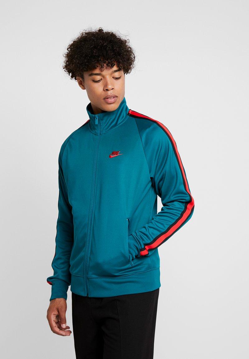 Nike Sportswear - TRIBUTE - Kurtka sportowa - geode teal/university red