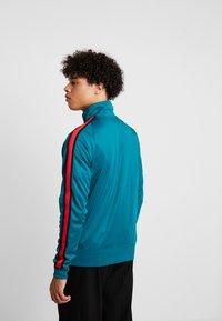 Nike Sportswear - TRIBUTE - Kurtka sportowa - geode teal/university red - 2