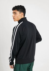 Nike Sportswear - TRIBUTE - Verryttelytakki - black - 2