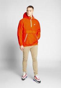 Nike Sportswear - Wiatrówka - magma orange/white - 1