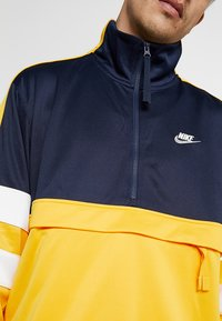 Nike Sportswear - AIR - Sweatshirt - obsidian/university gold/sail - 4