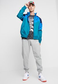 Nike Sportswear - Summer jacket - geode teal/battle blue/midnight navy - 1