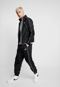 Nike Sportswear - SUIT BASIC - Tracksuit - black/white - 1