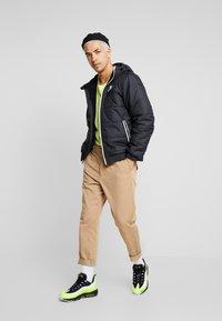 Nike Sportswear - Chaqueta de entretiempo - black/black/black - 1