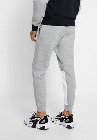 Nike Sportswear - SET - Survêtement - dark grey heather/black/white - 4