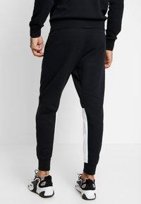 Nike Sportswear - SUIT - Trainingsanzug - black/white - 4