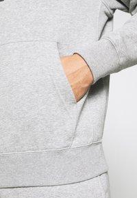 Nike Sportswear - TRACK SUIT - Träningsset - dark grey heather - 9