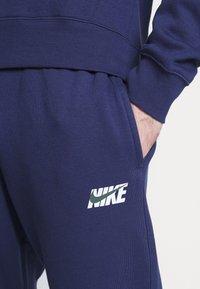 Nike Sportswear - M NSW CE TRK SUIT HD FLC GX - Tuta - midnight navy - 4