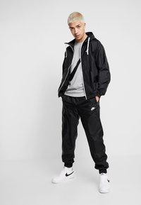 Nike Sportswear - SUIT  - Tracksuit - black - 1