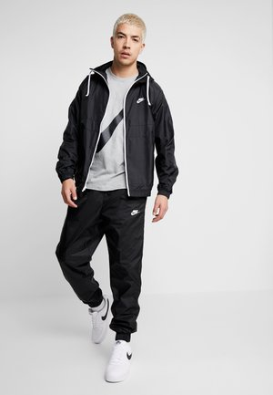 M NSW CE TRK SUIT HD WVN - Tracksuit - black