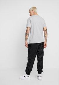 Nike Sportswear - SUIT  - Tracksuit - black - 5