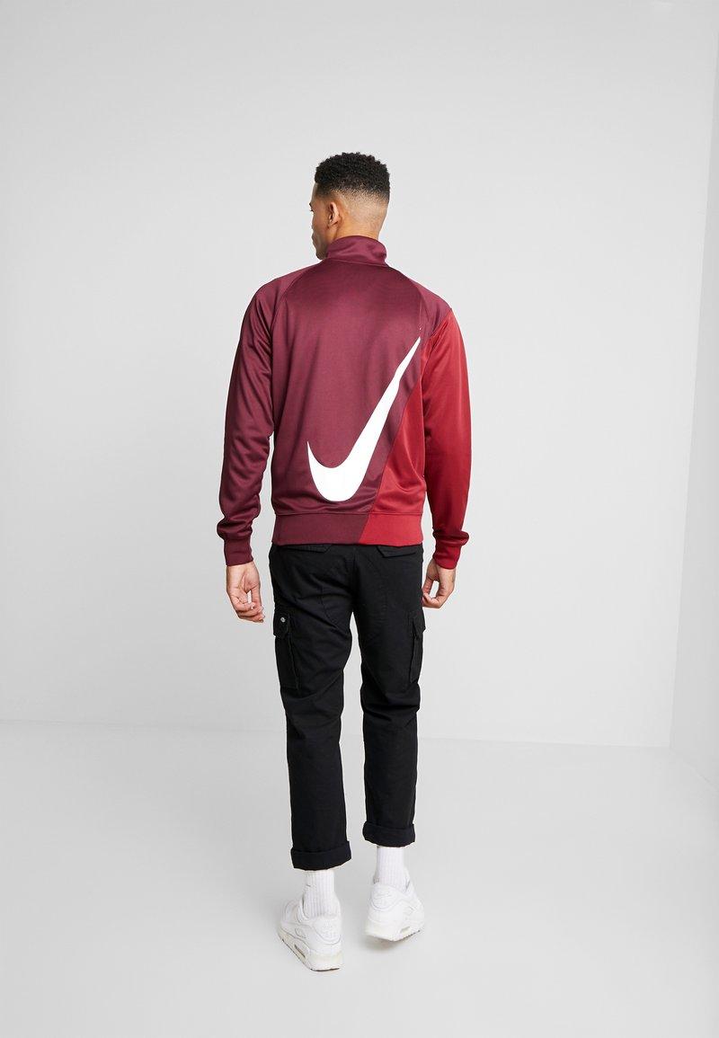 Nike Sportswear - Training jacket - night maroon/team red/white