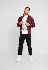 Nike Sportswear - Training jacket - night maroon/team red/white - 1