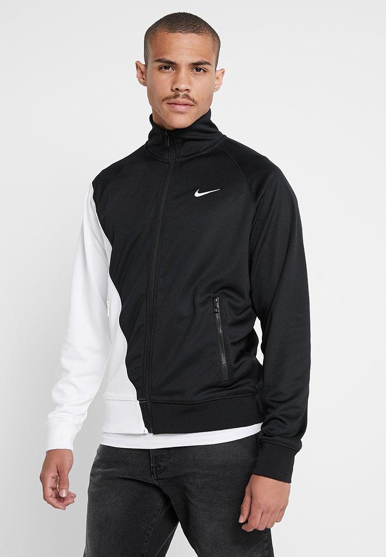 Nike Sportswear - Chaqueta de entrenamiento - black/white