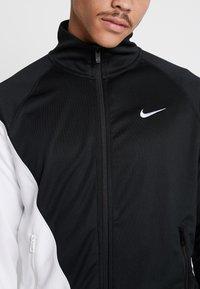 Nike Sportswear - Chaqueta de entrenamiento - black/white - 3
