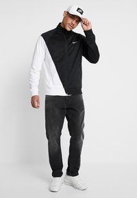 Nike Sportswear - Chaqueta de entrenamiento - black/white - 1