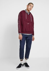 Nike Sportswear - Windbreaker - night maroon/white - 1