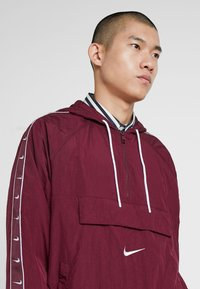 Nike Sportswear - Windbreaker - night maroon/white - 3