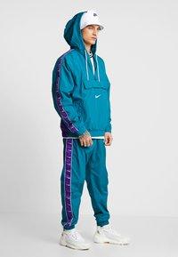Nike Sportswear - Windbreaker - geode teal/white/court purple/white - 1