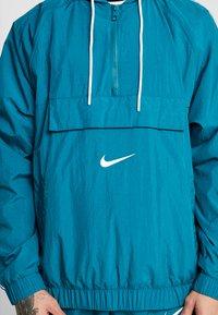 Nike Sportswear - Windbreaker - geode teal/white/court purple/white - 5