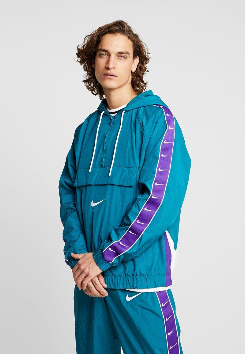 Nike Sportswear - Windbreaker - geode teal/white/court purple/white