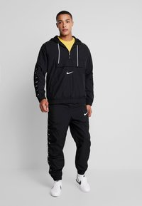 Nike Sportswear - Windbreaker - black/white - 1