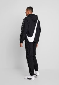 Nike Sportswear - Windbreaker - black/white - 2
