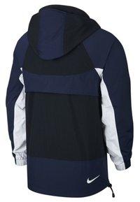 Nike Sportswear - RE-ISSUE - Windbreaker - black/obsidian/white - 1