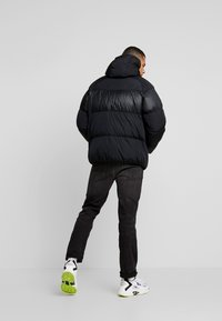 Nike Sportswear - Down jacket - black/black - 2