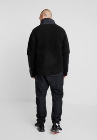 Nike Sportswear - WINTER - Kurtka wiosenna - black/off noir - 2