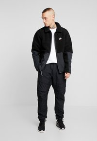 Nike Sportswear - WINTER - Kurtka wiosenna - black/off noir - 1