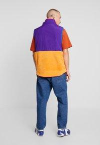 Nike Sportswear - VEST WINTER - Waistcoat - court purple/kumquat/starfish - 2
