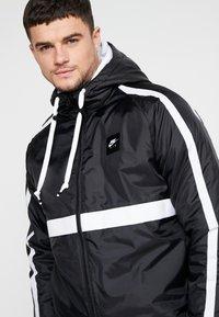 Nike Sportswear - Light jacket - black/white - 3