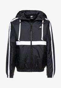 Nike Sportswear - Light jacket - black/white - 4