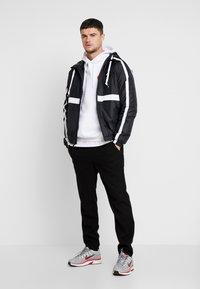 Nike Sportswear - Light jacket - black/white - 1