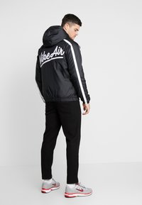 Nike Sportswear - Light jacket - black/white - 2