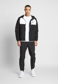Nike Sportswear - Lehká bunda - black/white/particle grey/(black) - 1