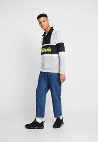 Nike Sportswear - M NSW NIKE AIR JKT PK - Summer jacket - smoke grey/black - 1