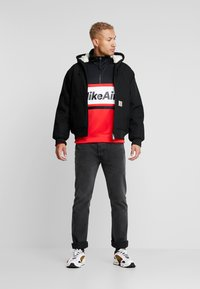 Nike Sportswear - M NSW NIKE AIR JKT PK - Summer jacket - university red/black/white - 1